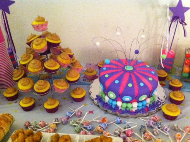 Beautiful topsy-turvy red velvet cake and pb+j cupcakes