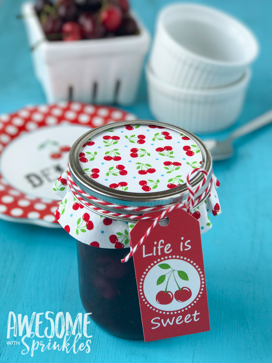 This delightful Rum Cherry Sauce made with fresh whole cherries is perfect for topping cheesecake, ice cream, pancakes and more! | Awesome with Sprinkles