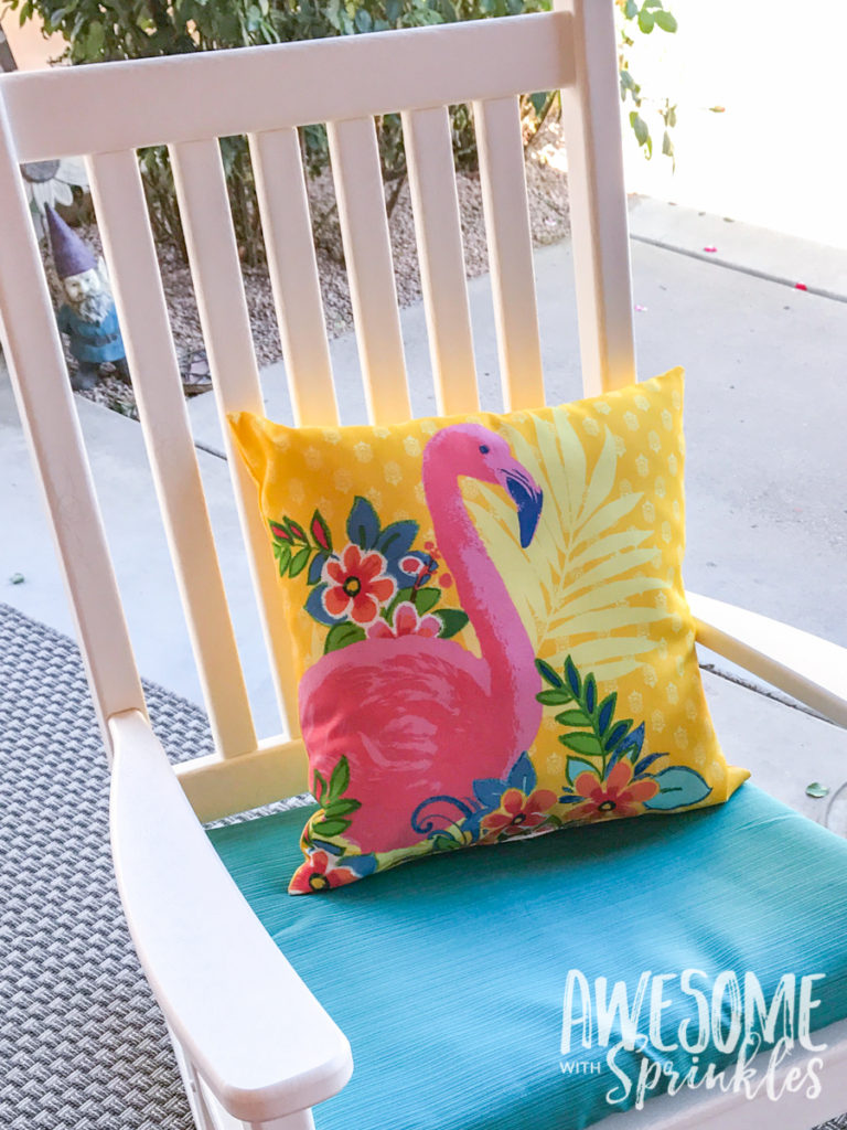 A cute flamingo patio toss pillow